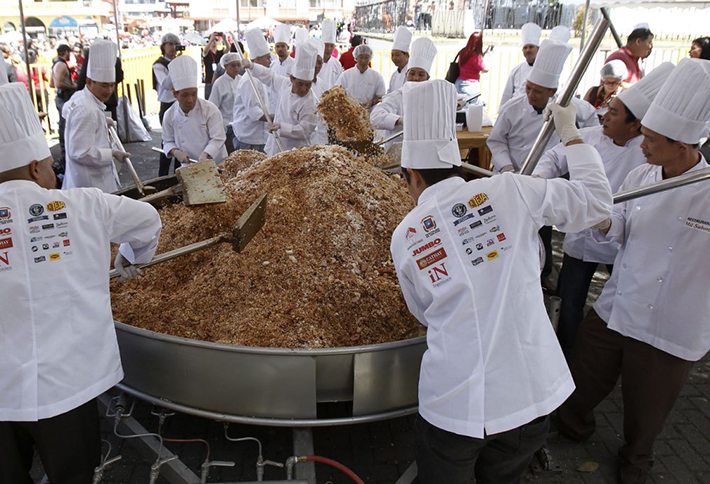 Chinese residents in Costa Rica cook Cantonese fried rice during Chinese Lunar New Year celebrations in Chinatown in San Jose