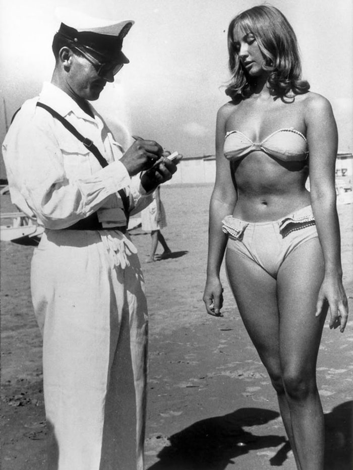 Police Officer issuing a woman a ticket for wearing bikini on ...